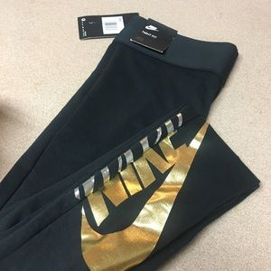 Nike Pants - Nike Sportswear High Rise metallic-logo leggings
